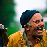 Farmer in the rain sharing a joke