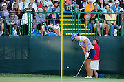 LYDIA KO takes a shot on the 18th green at the LPGA Championship at Monroe Golf Club in Pittsford, New York on August 17, 2014.