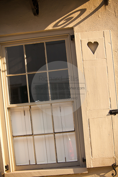 Antique window and shutter with heart Charleston, SC.