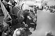 'Santa Claus', winner of the Epsom Derby, arrives home after his momentous victory. Mr Tim Rogers, (in hat), brother  of trainer Mick Rogers, sees the horse unloaded from the BKS aircraft.  .04.06.1964