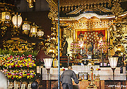 Monk praying inside Senso-ji Shrine<br /> Asakusa, Tokyo<br /> May 2015