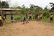 Boys playing football in Kromameng. The football pitch is the focal point of the community. It is surrounded by lush green cocoa plantations. It is a beautiful place to grow up in and to live but the youth are really struggling to find work outside of the cocoa harvesting season which runs from October to December.