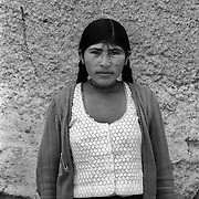 Zeri Julian, 14, Student. Potosi. Bolivia..Sitting at 4,090M (13,420 Feet) above sea level the small mining community of Potosi, Bolivia is one of the highest cities in the world by elevation and sits ?sky high? in the hills of the land locked nation. Overlooking the city is the infamous mountain, Cerro Rico (rich mountain), a mountain conceived to be made of silver ore. It was the major supplier of silver for the spanish empire and has been mined since 1546, according to records 45,000 tons of pure silver were mined from Cerro Rico between 1556 and 1783, 9000 tons of which went to the Spanish Monarchy. The mountain produced fabulous wealth and became one of the largest and wealthiest cities in Latin America. The Extraordinary riches of Potosi were featured in Maguel de Cervantes famous novel Don Quixote. One theory holds that the mint mark of Potosi, the letters PTSI superimposed on one another is the origin of the dollar sign. Today mainly zinc, lead, tin and small quantities of silver are extracted from the mine by over 100 co-operatives and private mining companies who still mine the mountain in poor working conditions, children are still used in the mines and the lack of protective equipment and constant inhalation of dust means miners have a short life expectancy with many contracting silicosis and dying around 40 years of age. UNESCO designated the historic city a World Heritage site in 1987. Most of Potosí's colonial churches have been restored, and tourism has increased. Potosi, Bolivia. 16th September 2011. Photo Tim Clayton