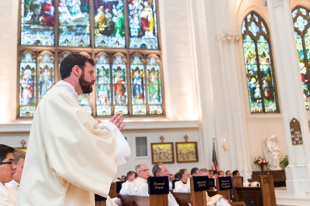 DENVER, CO - MAY 16: The Rev. Joseph Marc McLagan steps forward for his priest ordination for the Archdiocese of Denver at the Cathedral Basilica of the Immaculate Conception on May 16, 2015, in Denver, Colorado. (Photo by Daniel Petty/Denver Catholic Register)