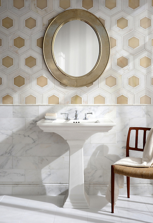 Ruche, a stone waterjet mosaic, shown in polished Calacatta, polished Thassos, and White Onyx, is part of the Aurora® collection by New Ravenna.