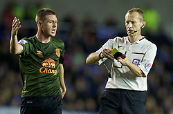 READING, ENGLAND - Tuesday, September 22, 2015: Referee Keith Hill shows a yellow card during the Football League Cup 3rd Round match between Reading and Everton at the Madejski Stadium. (Pic by David Rawcliffe/Propaganda)
