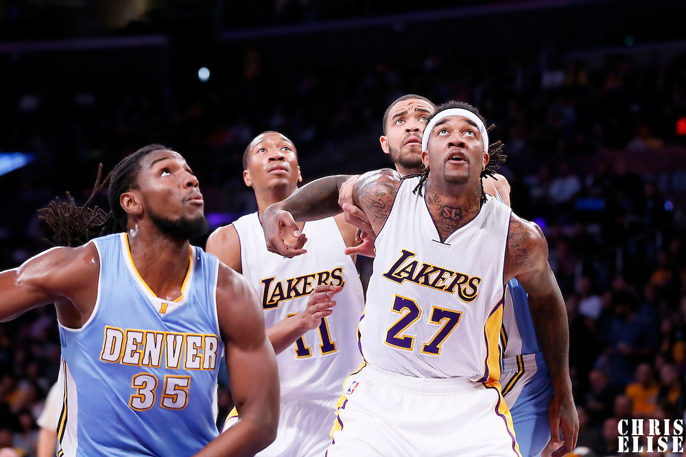 23 November 2014: Los Angeles Lakers center Jordan Hill (27) vies for the rebound with Denver Nuggets center JaVale McGee (34) and Denver Nuggets forward Kenneth Faried (35) during the Denver Nuggets 101-94 overtime victory over the Los Angeles Lakers, at the Staples Center, Los Angeles, California, USA.