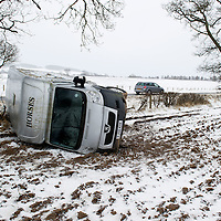 Treacherous conditions in Perthshire as a crashed horse box lies on it's side on the A94 Perth to Coupar Angus road near Balbeggie as snow contiues to fall and drift across the road in exposed areas.....23.03.13<br /> Picture by Graeme Hart.<br /> Copyright Perthshire Picture Agency<br /> Tel: 01738 623350  Mobile: 07990 594431