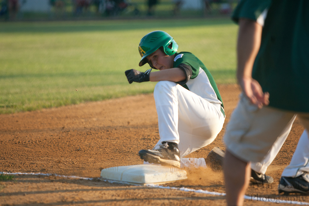 Audubon's Rich Giandrea slides into first on a triple during the District 14 Little League final held in Gloucester on Wednesday July 13th.