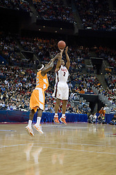 Virginia Cavaliers guard J.R. Reynolds (2) shoots one of his four first half three pointers over Tennessee Volunteers guard Ramar Smith (12).  The #4 seed Virginia Cavaliers were defeated by the #5 seed Tennessee Volunteers 77-74 in the second round of the Men's NCAA Tournament in Columbus, OH on March 18, 2007.