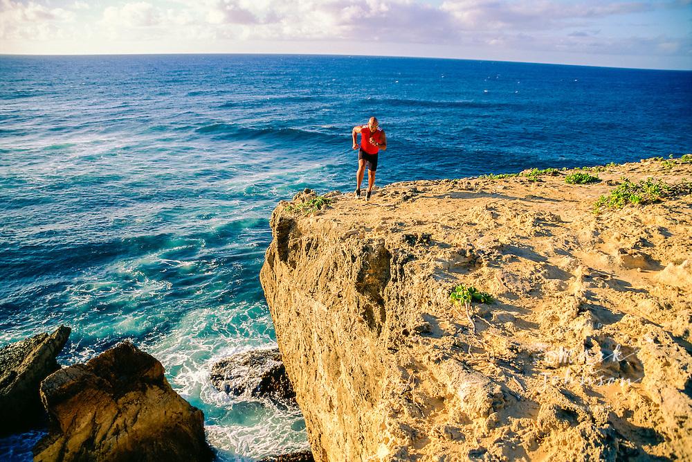 Jogger on the Kauai Coast
