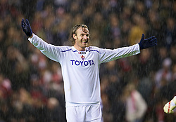 LIVERPOOL, ENGLAND - Wednesday, December 9, 2009: AFC Fiorentina's Cesare Natali celebrates his side's 2-1 victory over Liverpool during the UEFA Champions League Group E match at Anfield. (Photo by David Rawcliffe/Propaganda)