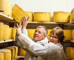 Scottish Lib Dem leader Willie Rennie gets to grips with one of the cheeses along with local candidate Elizabeth Richef when he visited St Andrews Farmhouse Cheese Company in Pitenweem in Fife in the run up to the 2017 General Election.<br /> &copy; Dave Johnston/ EEm