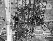 """AMAZING Photo Film discovered Documenting Work In Chernobyl <br />Chernobyl worker Aleksandr Shubovskiy captures rare images <br /><br />During one of the days in 1979-80, when the erection of Ventilation Stack VT-2 common for the third and fourth (not existed at that time) Chernobyl NPP Units was coming to the end, Aleksandr Shubovskiy, who was working within a combined installation crew in a company named """"Spetsenergomontazh"""", arranged with the colleagues a small photo session on his own,They had their pictures taken.<br /><br />The author processed the film and put it on a wardrobe without printing until he had time to print the images. The moment to print the film somehow did not happen, while in February 1986 Aleksandr hit the road for a on a different site in Yakutia. And there he was caught by news about the accident at Chernobyl.<br /><br />A year later, when a Aleksandr  managed to get into his looted flat in the evacuated Pripyat, he discovered an untouched package with films. He brought them home and… forgot for almost 40 years…the printed photographs which no one and never have seen before until now<br /><br />Photo shows: Welding at height.<br />©Aleksandr Shubovskiy/Exclusivepix Media"""