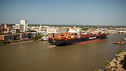 The Evergreen Triton sails upriver past Savannah's Historic River Street making it the first 14K TEU Evergreen vessel to call the East Coast and the Georgia Ports Authority's Port of Savannah, Tuesday, May, 21, 2019, in Savannah, Ga.  (GPA Photo/Stephen B. Morton)