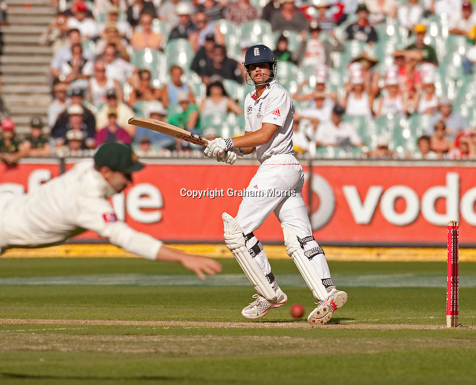 Alastair Cook past a diving Phillip Hughes for four during the fourth Ashes test match between Australia and England at the MCG in Melbourne, Australia. Photo: Graham Morris (Tel: +44(0)20 8969 4192 Email: sales@cricketpix.com) 26/12/10