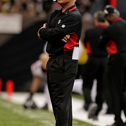 2009 November 02: Atlanta Falcons head coach Mike Smith watches from the sideline in the second half against the New Orleans Saints during a 35-27 win by the Saints over the Falcons at the Louisiana Superdome in New Orleans, Louisiana.