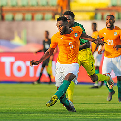 Wilfried Kanon of Ivory Coast clears the ball ahead of Lebo Mothiba of South Africa during the 2019 Africa Cup of Nations Finals game between Ivory Coast and South Africa at Al Salam Stadium in Cairo, Egypt on 24 June 2019  <br /> Photo : Icon Sport