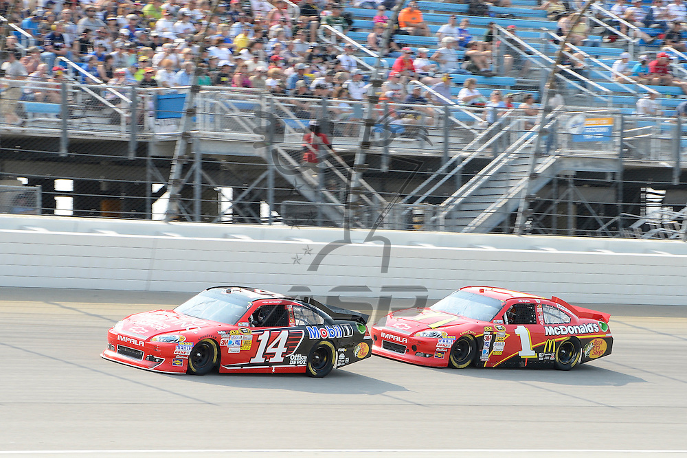 Joliet, IL - SEP 16, 2012: Tony Stewart (14) and Jamie McMurray (1) race during the Geico 400 at the Chicagoland Speedway in Joliet, IL.