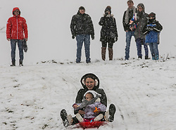 &copy; Licensed to London News Pictures.<br /> ESSEX,UK. 10/12/2017. Locals brave the freezing conditions to make the most of the heavy snow that fell on Sunday morning in Bedfords Park Essex. Photo credit: ANDREW BAKER/LNP