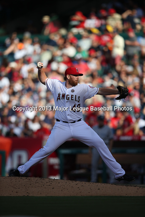 ANAHEIM, CA - JUNE 15:  Tommy Hanson #48 of the Los Angeles Angels of Anaheim pitches during the game against the New York Yankees on Saturday, June 15, 2013 at Angel Stadium in Anaheim, California. The Angels won the game 6-2. (Photo by Paul Spinelli/MLB Photos via Getty Images) *** Local Caption *** Tommy Hanson