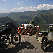 Benjamin Reich, of the UpperWest Side of Manhattan, NYC,  takes a break from motorbiking the open and winding roads of Ha Giang, Vietnam's northernmost province, 22 June, 2007. Reich is working as a businessman in Hanoi, where he has lived for 10 years. As cities like Hanoi and Ho Chi Minh roar with Vietnam's economic boom, Ha Giang remains a quiet, serene and beautiful mountain backwater along the Chinese border.