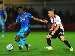 Joe Morrell of Cheltenham Town applies pressure on Siriki Dembele of Grimsby Town- Mandatory by-line: Nizaam Jones/JMP- 17/10/2017 - FOOTBALL - LCI Rail Stadium - Cheltenham, England - Cheltenham Town v Grimsby Town - Sky Bet League Two