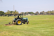 Tractor Mowing the lawn in a park