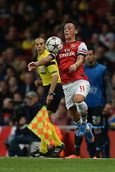 LONDON, ENGLAND - Oct 01: Arsenal's midfielder Mesut Ozil from Germany controls the ball during the UEFA Champions League match between Arsenal from England and Napoli from Italy played at The Emirates Stadium, on October 01, 2013 in London, England. (Photo by Mitchell Gunn/ESPA)