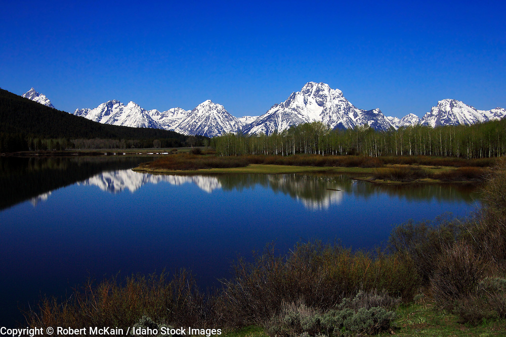 WYOMING. Teton National Park. Teton range in early spring reflected on the Snake River at Oxbow Bend, Mount Moran (12,605 ft.) prominent. #lm060003