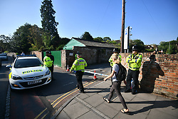 © Licensed to London News Pictures. 05/07/2018. Salisbury, UK. Police guard Queen Elizabeth Gardens in Salisbury, Wiltshire an area visited by two people who are in critical condition after being exposed to the Novichok nerve agent. Dawn Sturgess, 44, and Charlie Rowley, 45 hav been confirmed as having come in to contact with the deadly agent after samples were sent to the MoD's Porton Down laboratory. Former Russian spy Sergei Skripal and his daughter Yulia were poisoned with Novichok nerve agent in nearby Salisbury in March 2018 causing diplomatic tentions between Russia and the UK. Photo credit: Ben Cawthra/LNP