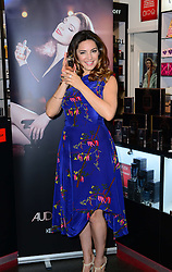 Model Kelly Brook launches her new fragrance at The Perfume Shop on Oxford Street, London, UK. Monday, 17th March 2014. Picture by Nils Jorgensen / i-Images