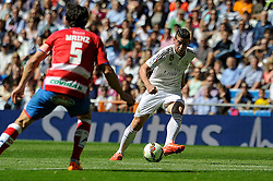 05.04.2015, Estadio Santiago Bernabeu, Madrid, ESP, Primera Division, Real Madrid vs FC Granada, 29. Runde, im Bild Real Madrid&acute;s James Rodriguez and Granada&acute;s Diego Mainz // during the Spanish Primera Division 29th round match between Real Madrid CF and Granada FC at the Estadio Santiago Bernabeu in Madrid, Spain on 2015/04/05. EXPA Pictures &copy; 2015, PhotoCredit: EXPA/ Alterphotos/ Luis Fernandez<br /> <br /> *****ATTENTION - OUT of ESP, SUI*****