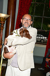 BRUCE OLDFIELD holding Becks the dog at the 6th Dogs Trust Honours held at Home House, Portman Square, London on 23rd July 2013.