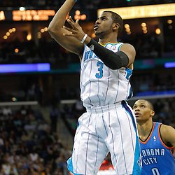 January 24,  2011; New Orleans, LA, USA; New Orleans Hornets point guard Chris Paul (3) shoots against the Oklahoma City Thunder during the second quarter at the New Orleans Arena. Mandatory Credit: Derick E. Hingle