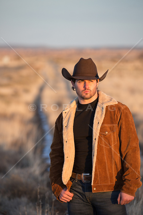 Hot All American cowboy outdoors on a ranch
