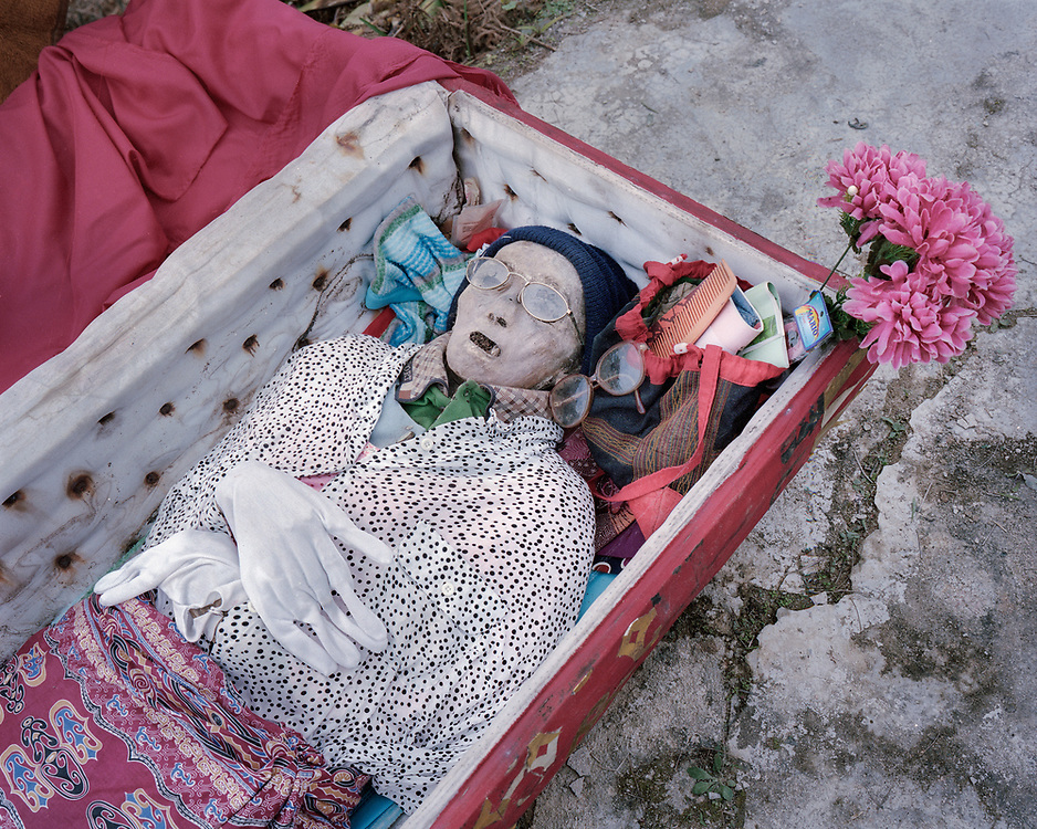 The coffin of a dead relative is open so the body could be dried under the sun.<br />