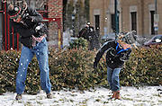 ANDREW JANSEN/JOURNAL<br /> Wickham Hardison, 9, Webster Groves, and Myron Lewis, Bloomington, Indiana, who is in town visiting friends, are both hit during a snowball fight during the Loop Ice Carnival in University City.