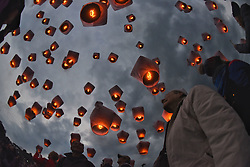 Feb. 11, 2017 - New Taipei, Taiwan, China - Tourists release sky lanterns to celebrate the Lantern Festival in New Taipei City. Lantern Festival is celebrated on the 15th day of the first Chinese lunar month, and traditionally ends the Chinese New Year period. (Credit Image: © Xinhua via ZUMA Wire)