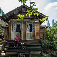Zainal Ibrahim, 76, reads a newspaper at a verandah of his 100 years old house in Kampung Baru, Kuala Lumpur, Malaysia, 19 April 2017. He was offered a hefty sum of money for the land, but he refused to accept the offer. He hope the government will preserve Kampung Baru as a Malay heritage for the years to come for young generation and tourist attraction.
