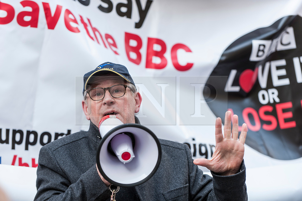 """© Licensed to London News Pictures. 23/11/2015. LONDON, UK. Former Doctor Who actor, Peter Davison, addresses fans of Doctor Who known as """"Whovians"""" and other supporters of the BBC gathered outside Broadcasting House in central London to oppose the threat of 20% government cuts to the Corporation which has brought shows such as Dr Who since 1922. Photo credit : Stephen Chung/LNP"""