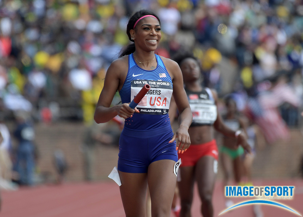Apr 28, 2018; Philadelphia, PA, USA; Raeven Rogers celebrates after running the 400m anchor leg on the USA Red women's sprint medley relay that won in a world-record 1:35.20 during the 124th Penn Relays at Franklin Field.