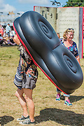 Inflatable chairs need to be carried to the Arena - The 2016 Latitude Festival, Henham Park, Suffolk.