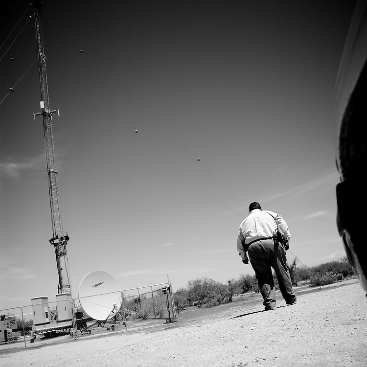 Sergeant Vincent E. Garcia of the Tohono O'odham Nation Police stands near surveilance equipment that is part of a U.S. Department of Homeland Security program known as Project 28 on Wednesday, July 16, 2008 in Newfield, AZ.