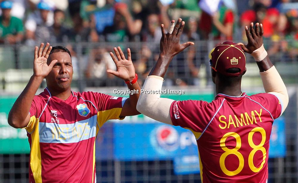 Samuel Badree celebrates Warner's wicket - West Indies v Australia, ICC World Twenty20, Bangladesh 2014. 28 March 2014, Sher-e-Bangla National Cricket Stadium, Mirpur. Photo: Shamsul hoque Tanku/www.photosport.co.nz