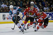 KELOWNA, CANADA - JANUARY 21:  Kelowna Rockets right wing Kole Lind #16, Portland Winterhawks defenseman Conor MacEachern #4 and Portland Winterhawks center Brad Ginnell #27 at the Kelowna Rockets game on January 21, 2017 at Prospera Place in Kelowna, British Columbia, Canada.  (Photo By Cindy Rogers/Nyasa Photography,  *** Local Caption ***