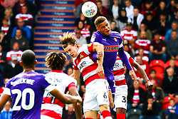 Carlton Morris of Rotherham United and Ben Sheaf of Doncaster Rovers jump to head the ball - Mandatory by-line: Ryan Crockett/JMP - 07/09/2019 - FOOTBALL - The Keepmoat Stadium - Doncaster, England - Doncaster Rovers v Rotherham United - Sky Bet League One