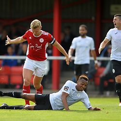 TELFORD COPYRIGHT MIKE SHERIDAN PENALTY. Marcus Dinanga of Telford is fouled by Gareth Dean during the National League North fixture between Brackley Town and AFC Telford United at St James's Park on Saturday, September 7, 2019<br /> <br /> Picture credit: Mike Sheridan<br /> <br /> MS201920-016