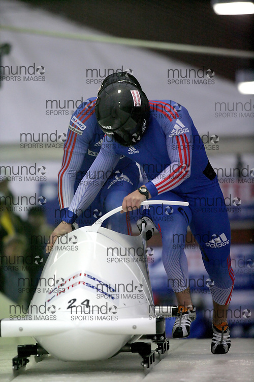 (November 21, 2009) Evgeny Popov (front) and Evgeny Pechenkin of Russia push in the first run en route to a 12th place finish at  the Federation Internationale de Bobsleigh et de Togogganing (FIBT) two-man men's bobsled World Cup race at the Olympic Sports Complex in Lake Placid, New York.