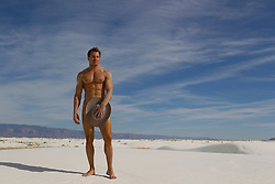 nude man holding a cowboy hat in front of his crotch in White Sands, NM